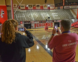 Whitney Winch, a YSU Junior, marketing management major, (left) and Ben Dalrymple, a YSU Junior, psychology major, (right) take photos of the HOPE displayed during the Luminaria Ceremony at Relay for Life at Beeghly Center on the campus of Youngstown State University on Saturday April 14, 2018.