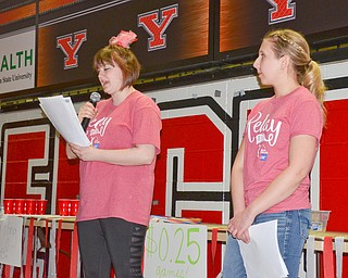 Maddie Sanders, a YSU Junior, early childhood education major, (left) and Gianna DeToro, a YSU Junior, early childhood education major, read the names of those who are battling cancer and those who have passed away from cancer on paper bags for the Luminaria Ceremony at Relay for Life at Beeghly Center on the campus of Youngstown State University on Saturday April 14, 2018.