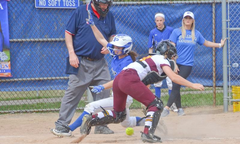 Poland baserunner Brooke Bobbey scores as South Range catcher Jillian Strecansky retrieves the ball during Saturday's game in Poland. The Bulldogs rallied for a 12-8 victory.