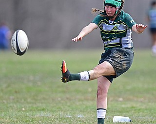 YOUNGSTOWN, OHIO - APRIL 14, 2018: Abby Waine kicks the ball for the point after try during a rugby match, Saturday morning in Youngstown. DAVID DERMER | THE VINDICATOR