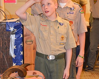 Boy Scouts Cole Williams (left) and Patrick Kelly lead the room in the Pledge of Allegiance at the Whispering Pines Recognition Dinner at St. James Episcopal Church in Boardman on Sunday, April 15, 2018.  Photo by Scott Williams - The Vindicator
