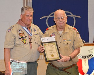Kurt Hilderbrand, left, presents Walter Fowles with a 60 years of service award at the Whispering Pines Boy Scouts Recognition Dinner at St. James Episcopal Church in Boardman on Sunday, April 15, 2018.  Photo by Scott Williams - The Vindicator