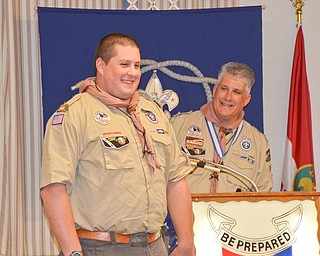 Kurt Hilderbrand, right, recognizes his son Kent at the Whispering Pines Boy Scouts Recognition Dinner at St. James Episcopal Church in Boardman on Sunday, April 15, 2018.  Kent received the Summit Award, which is the highest award in venturing.  Photo by Scott Williams - The Vindicator