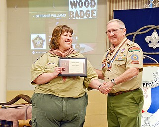 Bill Moss, district training chairman, (right) presents Stephanie Williams with the Wood Badge award at the Whispering Pines Recognition Dinner at St. James Episcopal Church in Boardman on Sunday, April 15, 2018.  The Wood Badge is an advanced, national leadership course open only to Scouting volunteers and professionals.