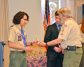 Byron Harnishfeger, district advancement chairman, presents awards to Eagle Scouts Diego Calderon (left) and Victor DiTommaso at the Whispering Pines Recognition Dinner at St. James Episcopal Church in Boardman on Sunday, April 15, 2018.