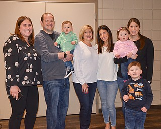 A family of generations: Every person in this photo either a second, third, or fourth generation Holocaust survivor.  From left to right, they are: Katie Kinast, 3rd generation; Ian Anderson, 3rd generation holding Jack Anderson, 4th generation; Terri Anderson, 2nd generation; Morgan Anderson, 3rd generation; Molly Kay, 4th generation, being held by mom Rachel Kay, 3rd generation; and Ethan Kay, 4th generation.  They gathered at the Jewish Community Center for a Shoah Memorial Ceremony Sunday, April 15, 2018.
