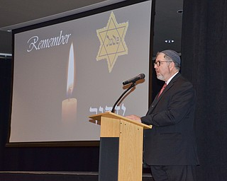 Rabbi Joseph Schonberger welcomes guests to the Shoah Memorial Ceremony held at the Jewish Community Center on Sunday, April 15, 2018.