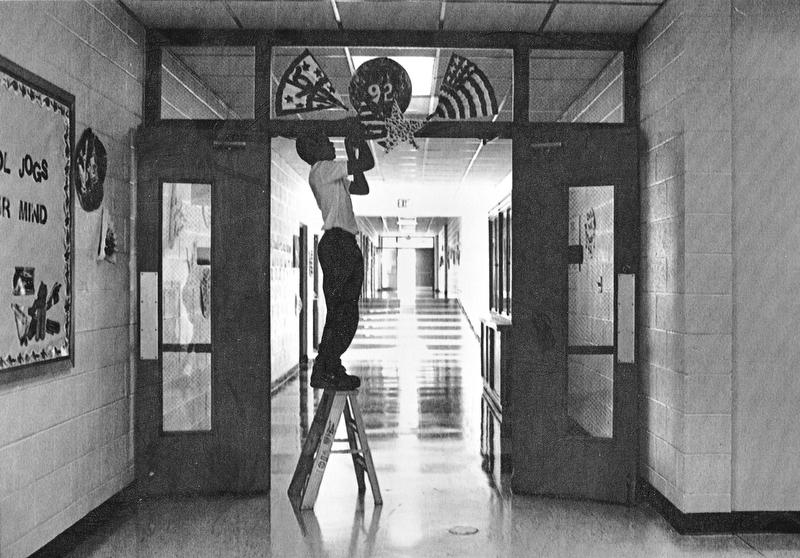 PREPARING FOR BUSH - St. Luke student Joe Cassese, 13, decorates the halls early Thursday morning preparing for a visit from Mrs. Bush.    Photo taken September 17, 1992.    Photo by Doug Oster - The Vindicator