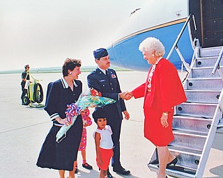 From left, Mrs. Wendy Pieczynski, Lt. Col. Ben Pieczynski, and Mrs. Barbara Bush at the Youngstown Air Reserve Station on September 17, 1992.  