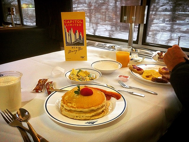 """""""Dinner (or breakfast) in the diner, nothing could be finer"""" as the song goes.  This, however, could be changing on two Amtrak trains that pass through northeast Ohio as Amtrak has announced to cut the traditional dining car from the trains.    Here, in this March 5, 2016 photo, breakfast is served on the westbound Capitol Limited en route to Chicago in a sit-down, restaurant style setting.    Photo by Scott Williams - The Vindicator"""