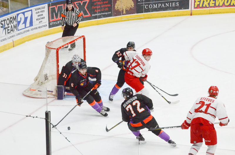 Youngstown Phantom #5, Jason Smallidge, gets the puck away from their net as Phantoms #52, Craig Needham, and Phantoms #72, Liam Dennison, keep Dubuque Fighting Saints #17, Tyce Thompson, and #21, Alex Steeves, respectively, back as well during the second game of the USHL playoff at the Covelli Center on Saturday, April 21, 2018.  