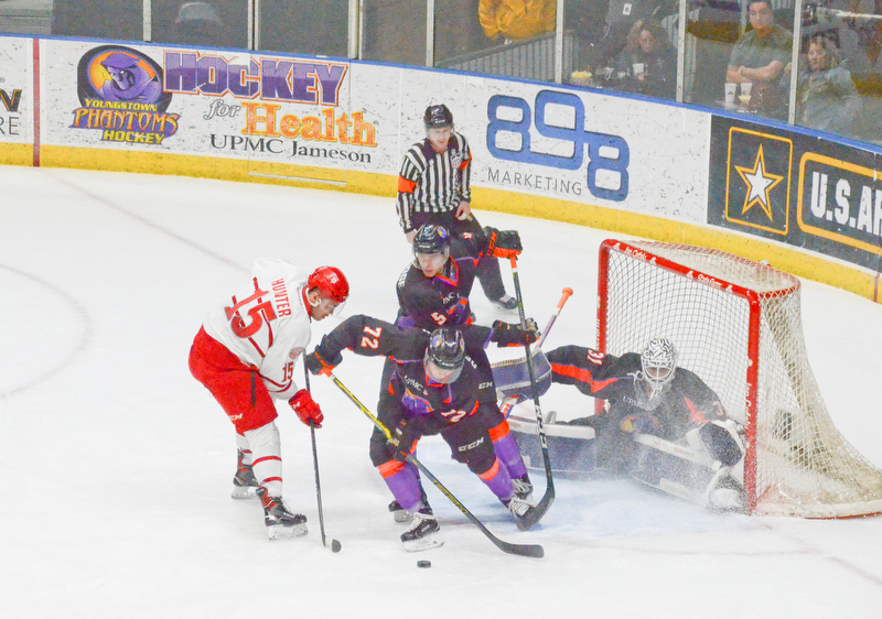 Youngstown Phantom #72, Liam Dennison, and #5, Jason Smallidge, stop Dubuque Fighting Saints #15, Dalton Hunter, from putting the puck in the net during the second game of the USHL playoff at the Covelli Center on Saturday, April 21, 2018.  