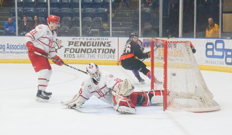 Youngstown Phantom #26, Matthew Barry, looks back at the puck that he just put in the net past Dubuque Fighting Saints #35, Cole Weaver, during the second game of the USHL playoff at the Covelli Center on Saturday, April 21, 2018.  