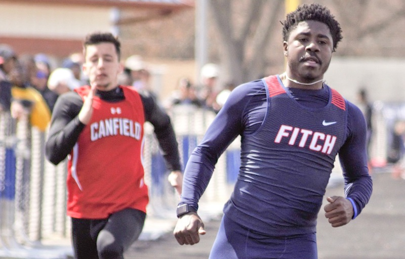 Ralph Fitzgerald of Austintown Fitch runs away from the field in the Division I 100 at the Mahoning County Track and Field Championships on Saturday at Fitch High School. Fitzgerald helped the Falcons win the Division I boys team championship.