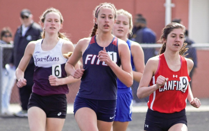 Lauren Dolak of Austintown Fitch, center, attempts to outduel Ashley Ventimiglia of Canfield, right, and Casey Zaitzew of Boardman, left, as Gianna Stanich of Poland, back, also tries to stay with the leaders at the Mahoning County Track and Field Championships on Saturday at Fitch High School.