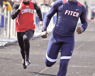 Ralph Fitzgerald of Austintown Fitch runs away from the field in the Division I 100-meter dash at the Mahoning County Track and Field Championships at Fitch High School on Saturday. Fitzgerald captured the Division I boys Rob Ruane Award for the meet.