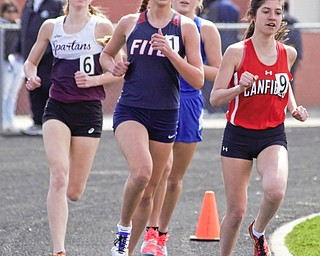 Lauren Dolak of Austintown Fitch (center) attempts to outduel Ashley Ventimiglia of Canfield (right) and Casey Zaitzew of Boardman (left) as Gianna Stanich of Poland (back) tries to hold on to the leaders at the Mahoning County Track and Field Championships at Fitch High School on Saturday. Fitzgerald captured the Division I boys Rob Ruane Award for the meet. Dolak won the Division I girls Rob Ruane Award.