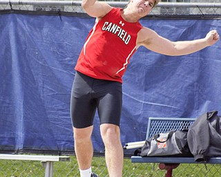 Michael Minenok of Canfield heaves the shot put at the Mahoning County Track and Field Championships at Fitch High School on Saturday.