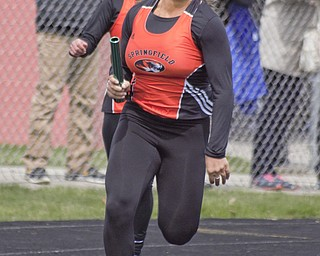 Shantel Springer of Springfield takes the baton from Haley LaMorticella in the 400-meter dash at the Mahoning County Track and Field Championships at Fitch High School on Saturday.