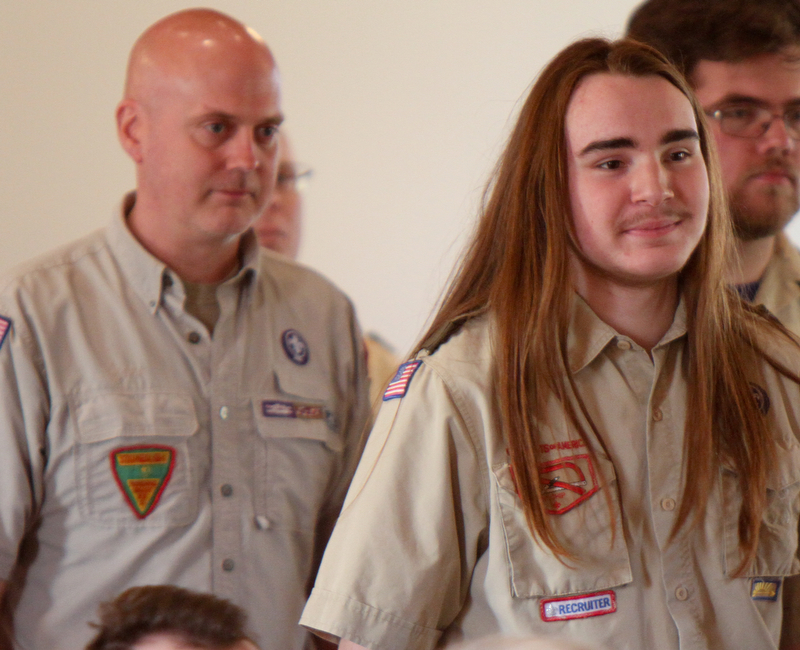 William D. Lewis The Vindicator  Isaac Coxson, 18, and member of Troop 55 of Youngstown is followed by his scoutmaster Rick Cook Jr. into Eagle Scout Court of Honor at Corner House Christian Church in Hubbard 4-22-18. Coxson was awarded his Eagle  during the event..
