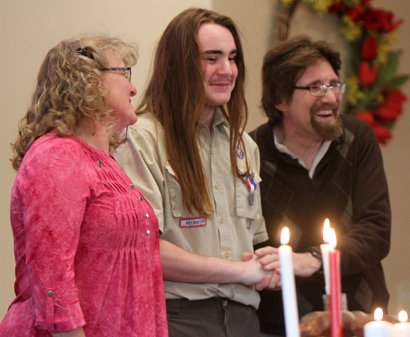 William D. Lewis The Vindicator Isaac Coxson, 18, member of Boy Scout Troop 55 of Youngstown gets congrats ffrom his parents Rev. David Coxson and Kim Coxson after recieving his Eagle .Scout award at a court of honor at Cornerhouse Christian Church in Hubbard where his father is pastor. Isaac's Eagle service project was collecting more than 20 musical instruments for the HubbardHS band of which he is a member.