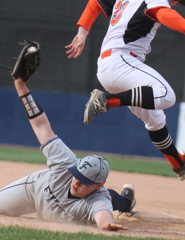 William D. Lewis The Vindicator  Fitch 1rst baseman Robby Russo(24) tags Howland's Dylan Beasom(23) during 4-23-18 action at Eastwood.