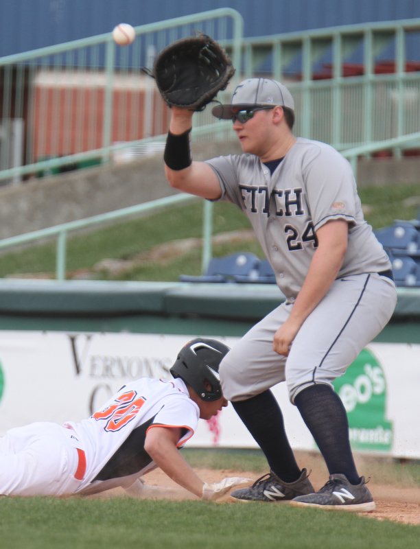 William D. Lewis the Vindicator Fitch 1rst baseman Robby Russo waits for the throw as Howland's Josh McLeery(30) dives back to the bag during a pickoff attempt 4-23-18 at Eastwood.