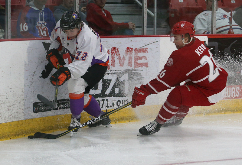 Dubuque Fighting Saints' Jan Kern (right) battles Youngstown Phantoms' Liam Dennison during their hockey game at Mystique Community Ice Center in Dubuque on Tuesday, April 24, 2018.