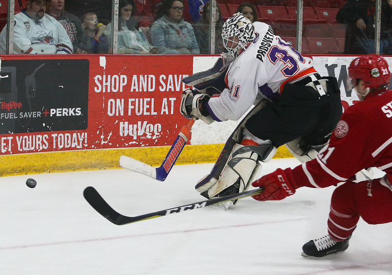 Youngstown Phantoms' goalie Ivan Prosvetov hits the puck to the corner during their hockey game against the Dubuque Fighting Saints at Mystique Community Ice Center in Dubuque on Tuesday, April 24, 2018.