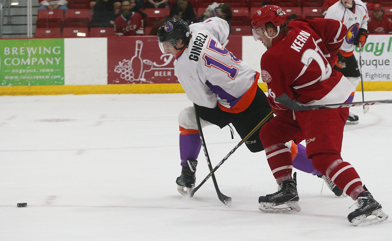 Youngstown Phantoms' Jake Gingell (left) tries to stop Dubuque Fighting Saints' Jan Kern during their hockey game at Mystique Community Ice Center in Dubuque on Tuesday, April 24, 2018.
