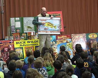 """Neighbors   Zack Shively.""""Buck Wilder"""" author Tim Smith writes and illustrates his books. He showed the Dobbins Elementary students a sample drawing from a book that demonstrated his style of placing words sideways or upside-down."""