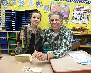 Neighbors   Zack Shively.Dobbins Elementary had a father daughter night on March 20. The night included a series of different stations, including one where the child and parent worked on a project together. Pictured, Sofia and Frank Elia work together to make a birdhouse.