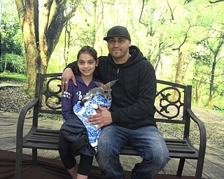 Neighbors   Zack Shively.The PTO of Dobbins Elementary organized the father daughter night. They set up a station where parents and children could get their pictures taken with a small kangaroo. Pictured are Alivia Carbone and Tony Cruz.
