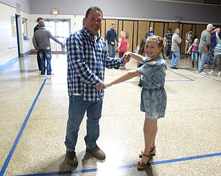 Neighbors   Zack Shively.The Dobbins Elementary father daughter night featured a dance in the gymnasium with music by DJ Bob Hlinka of Music Man DJ Services. Pictured are Bob DiFabio and his daughter Juilanna.