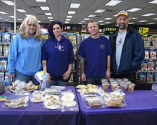 Neighbors   Zack Shively.Legacy Dog Rescue and F5RS had a bake sale and Easter pictures at Family Video in Austintown on March 25. Pictured are Jennifer Overmier, Erin Yale, Pete Yale and Blase Brush of Legacy Dog Rescue. They rescue dogs and find new homes for them as well as spay or neuter dogs.