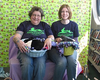 Neighbors   Zack Shively.Frisky Ferrets, Fuzzies and Feathered Friends Rescue and Sanctuary (F5RS) gave families the opportunity to take photos with their trained therapy rabbits at Family Video. Pictured are F5RS volunteers Sassy Pickard and Barb Ricker. The organization provides homes for rescued animals as well as community outreach with their trained rabbits.