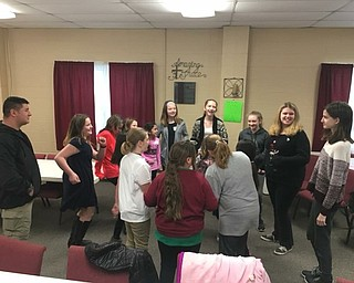 Neighors   Submitted .Sergeant Wade Boley of the Columbiana Police Department led members of Girl Scout Troops 80191 and 80777 in Columbiana and 80018 in Canfield in a Circle of Friends activity centered on character as it relates to standing up against bullying.