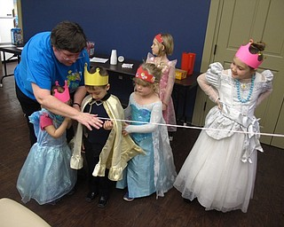 Neighbors   Zack Shively.The Boardman library does many children events with different themes. The medieval theme allowed them to play a number of different games and hear interesting stories about knights and kingdoms. Pictured, librarian Karen Saunders helped a child make a Rapunzel braid or fishing line out of yarn.