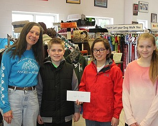 Neighbors   Abby Slanker.Canfield Village Middle School Ambitious Citizens for Empathy Charity Committee members, from second on left, Matthew Logan, A.J. Helmick and Emily Heino presented a donation of $500.84 to Diane Less, co-founder of Angels for Animals, on March 31. Missing from photo is committee member Anna Kerns.