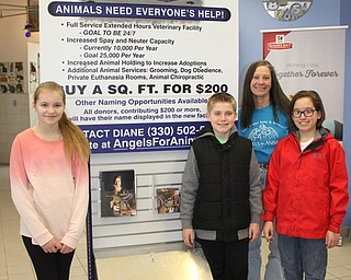 Neighbors   Abby Slanker.With the help of Angels for Animals co-founder Diane Less (back), Canfield Village Middle School Ambitious Citizens for Empathy Charity Committee members , from left, Emily Heino, Matthew Logan and A.J. Helmick decided to buy two of the 1-square-foot blocks in the new Angel Wing building with money they raised and donated to the organization on March 31. Missing from photo is committee member Anna Kerns.