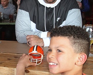 William D. Lewis The Vindicator Brian Briggs, 9, of Youngstown poses for a photo with NFL star John Greco during draft night event at Suzies Dogs and Drafts in Boardman.