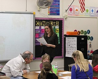 Neighbors   Abby Slanker.C.H. Campbell Elementary School first-grade teacher Alyssa Carbon read a poem to first-graders and their families during the school's Literacy Night on April 11.