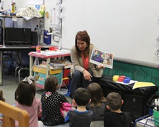 Neighbors   Abby Slanker.C.H. Campbell Elementary School kindergarten teacher Tammy Sabrin read a book to kindergartners and their families during the school's Literacy Night.