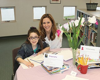 Neighbors   Abby Slanker.Second-grader Giuliana Sebastiani and her mother, Michelle, visited the Book Tasting in the library during the school's Literacy Night.