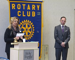 Neighbors   Zack Shively.Each representative that received money from the Poland Rotary spoke briefly about what the organization will do with the funds. Pictured is Liz McGarry of Hospice of the Valley. The organization will use the money for free care for uninsured patients and maintaining the Hospice House.
