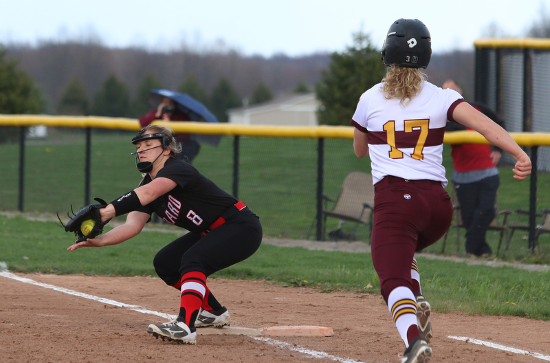 Girards Emma Markulin (8) catches a ball at first base to force out South Range's Bree Kohler (17) during Friday afternoons game at South Range.  Dustin Livesay  |  The Vindicator  4/27/17 South Range High School.
