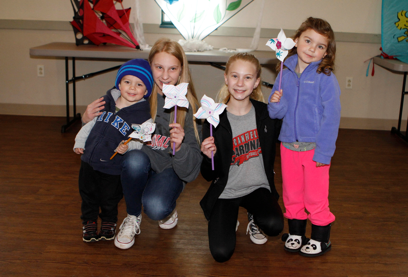 L-R) Cousins, Daniel Miller(2) , Carlie Harmon (13), Kaylie Harmon (11), and Ella Miller (4) made pinwheels during the Kite Festiival at the Mill Creek Metro Parks Farm in Canfield on Saturday morning.    4/28/18  Dustin Livesay     The Vindicator    Mill Creek Park
