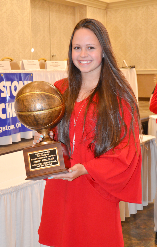 Emily Williams, from Jackson-Milton High School, holds her Curbstone Coaches Byrd Giampetro Student Athlete of the Year award at the Curbstone Coaches Basketball Recognition Banquet at the Our Lady of Mount Carmel Social Hall in Youngstown on Sunday, April 29, 2018.    Photo by Scott R. Williams - The Vindicator
