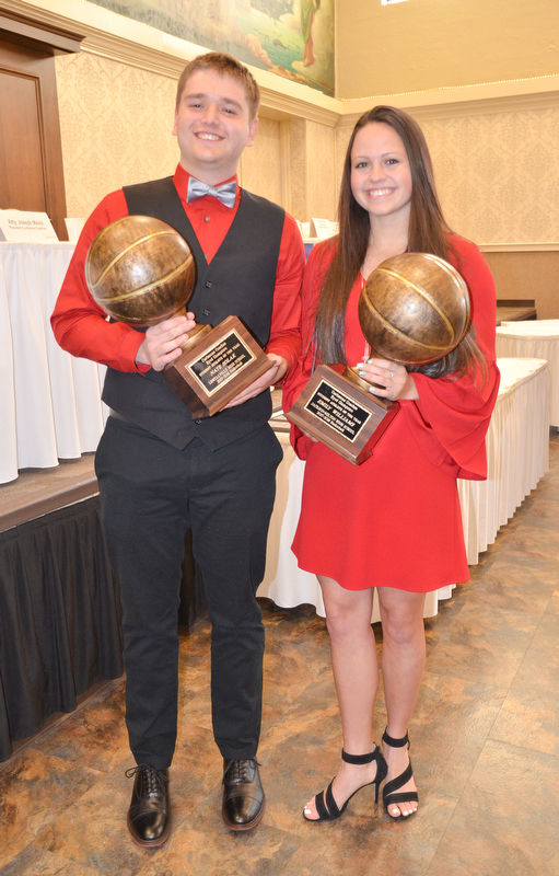 Nate Solak, from Lowellville High School, (left) and Emily Williams, from Jackson-Milton High School, hold their Curbstone Coaches Byrd Giampetro Student Athlete of the Year awards at the Curbstone Coaches Basketball Recognition Banquet at the Our Lady of Mount Carmel Social Hall in Youngstown on Sunday, April 29, 2018.    Photo by Scott R. Williams - The Vindicator