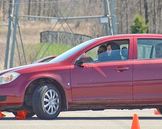 Dillon Burnside, 16, from Kensington, OH, navigates a fast pace skid control exercise, and plows over some cones, at a TireRack.com Street Survival School event at Boardman Park on Sunday, April 29, 2018.    Photo by Scott R. Williams - The Vindicator